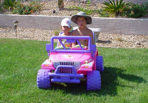 Kiri and Baily In Their Jeep